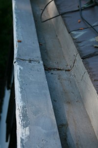 Cracks in the gutter seams, such as the one seen here, could go undetected if proper maintenance of a built-in gutter is neglected