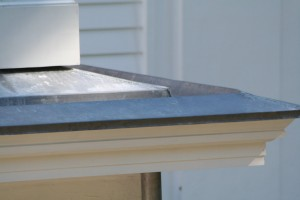A view of a built-in gutter on a Greek Revival home