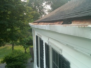 A sagging built-in gutter that pulled away from the house, allowing water to run down the side of the house and cause damage