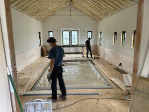 radiant heated floors in pool barn